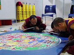 Monks creating sand mandala